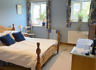 Image of a double bedroom at the Long House East Meon
